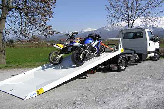 Two motorcycles on a flatbed truck | Tow a Motorcycle Properly | https://www.sfcitytowing.com