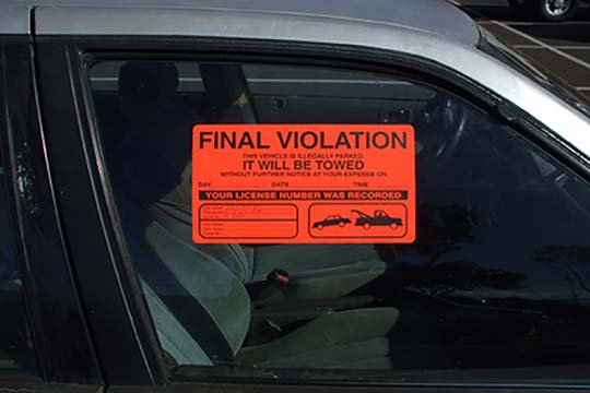 Car blocking driveway with final violation notice | San Francisco Bay Area Towing