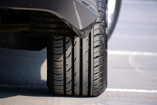 choosing tires for your car | a vehicles rear passenger tire viewed from the ground