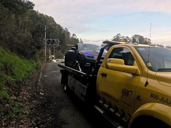 Flatbed tow truck towing a porsche 911 | San Francisco Bay Area Towing