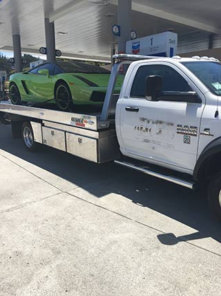 Lamborghini on Flatbed tow truck near Market Street | San Francisco Bay Area Towing