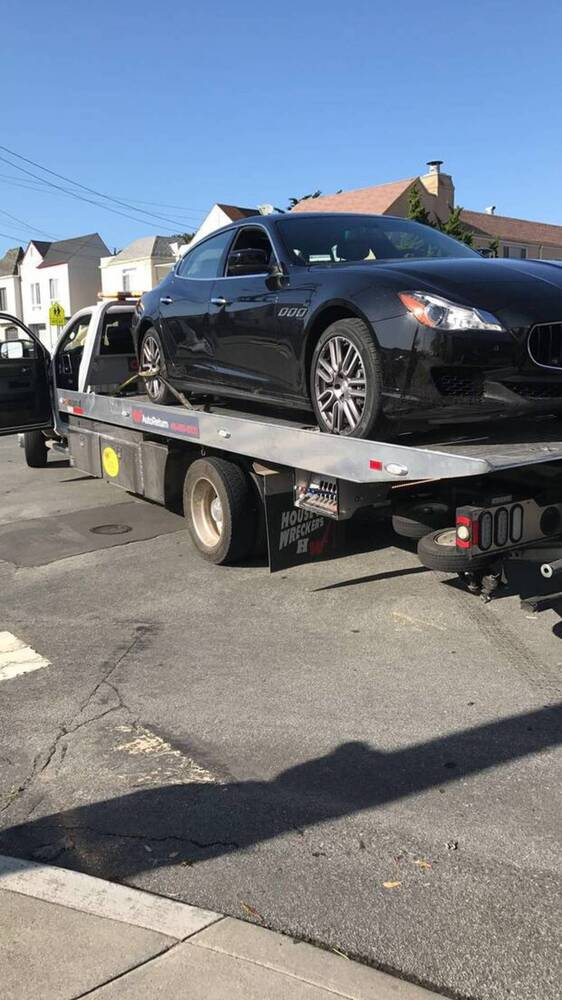 Excelsior sf towing service on flatbed tow truck